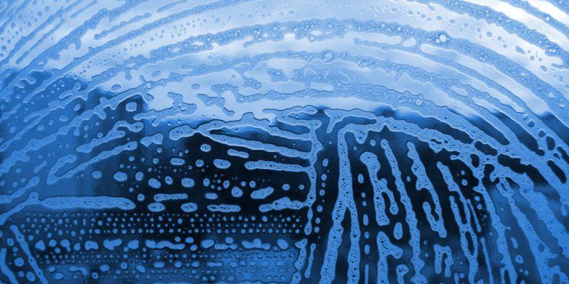 soap foam bubbles on the glass